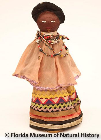 Figure 24: Paper mache doll, Seminole (E1027) Cotton cloth, paper mache, wood. Circa 1950-1960, 32.1cm. Donated by the Caprons.