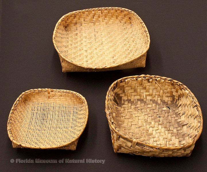 "Three baskets, Miccosukee/Seminole, split palmetto stems, upper: basket tray, 1939, 13.8"" long (92917); lower left: basket sieve, 1939, 11.4"" long (92907), lower right: basket tray, early 20th century, 13.7"" long (92903)."