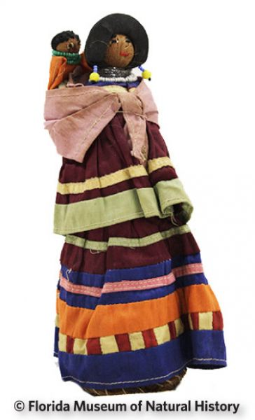 Figure 13: Female doll, Seminole (2013-36-5) Palmetto fiber, cotton cloth. Circa 1940s, 20.96cm. Donated by Keith and Sara Reeves.