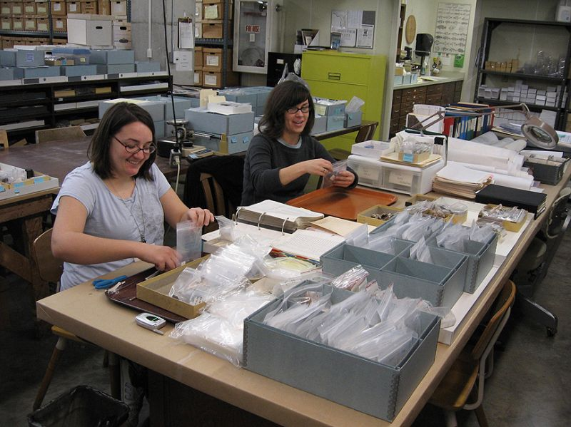 Ryan VanDyke and Melissa Ayvaz work on rebagging specimens and samples from the Pineland Site Complex.