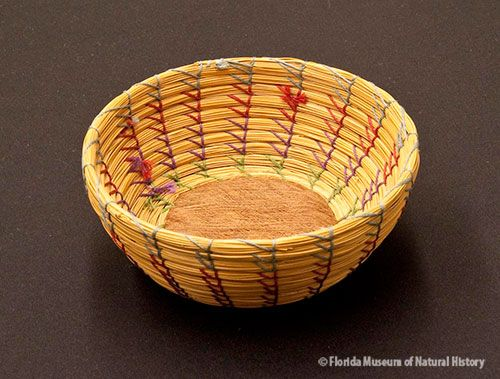 Basket, Seminole, sweetgrass, cotton thread, palmetto fiber, ca. 1930-1950, 5 x 11.5 cm. Donated by Solon T. Kimball (83-7-E853).