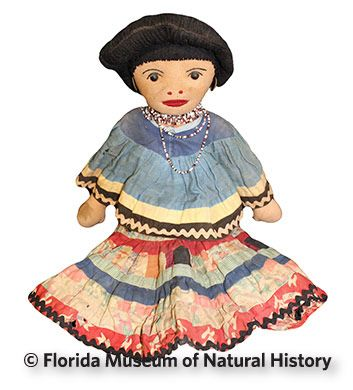 Figure 19: Female doll, Miccosukee (2013-30-4) Cotton cloth, yarn, glass beads. Post 1950, 47.cm. Donated by Anne Reynolds.
