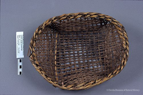 Basket, Miccosukee, split palmetto, plain weave, ca. 1942, 7.5 x 30 x 23 cm. Collected at Hollywood, FL by John M. Goggin (3933-92918).