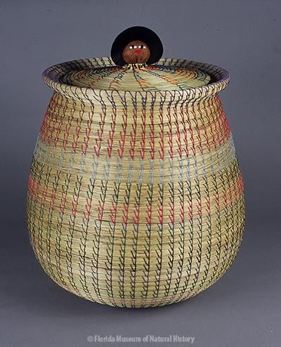 Basket, Seminole, sweetgrass, cotton thread, palmetto fiber, cotton cloth, glass beads, ca. 1990s, 50.8 cm. Made by Agnes Cypress and Lucy Johns, donated to the FLMNH by the Seminole Tribe of Florida (97-8-1).