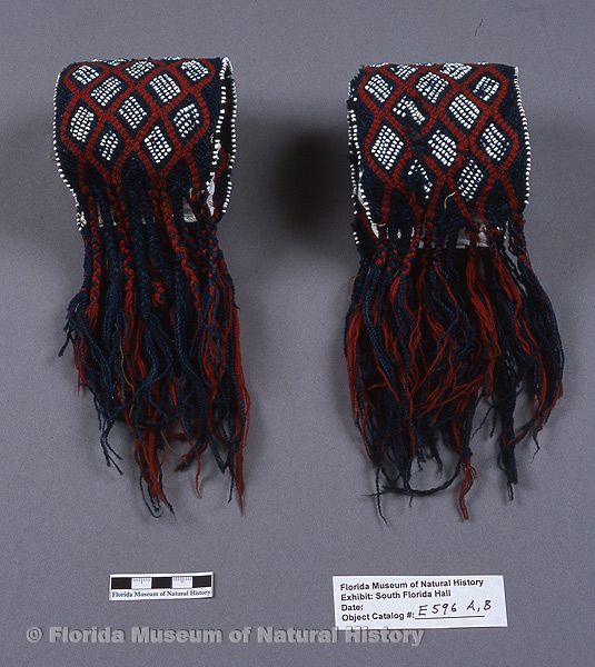 "Garters, fingerwoven, Seminole, wool yarn, glass beads, ca. 1830s-1840s, 8.3"" long (E-596)."