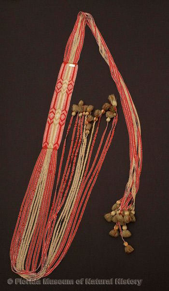 "Sash, fingerwoven, Seminole, wool yarn, glass beads, ca. 1830s-1840s, 4.0"" wide at center (E-600)."