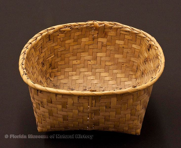 "Basket, Seminole, split saw palmetto stems, 1943, purchased at Musa Isle, 7.5"" long (92921)."