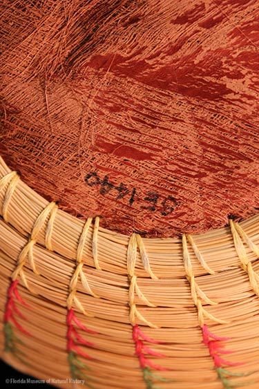 Basket, Seminole, sweetgrass, cotton thread, palmetto fiber, circa 20th c., 7.6 x 17.7 cm. Donated by Keith and Sara Reeves (2012-46-9).