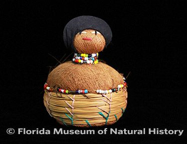 Figure 21: Seminole pincushion doll. (2012-50-1) Palmetto fiber, sweetgrass, cotton cloth, glass beads. Circa 1950 - 1960s, 10cm. Donated by Anne Reynolds.