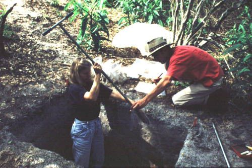 Assisted by Scott Mitchell, Sylvia Scudder takes a soil sample from the Smith Mound, Pineland Site Complex, 1992.