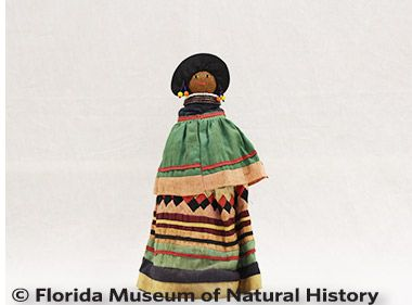 Figure 7: Female doll, Seminole (2012-46-3) Palmetto fiber, cotton cloth, glass beads. Circa 1950-1960s, 24.92cm Donated by Keith and Sara Reeves.