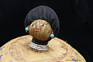 Figure 4: Basket, Seminole, sweetgrass, cotton thread, palmetto fiber, cardboard, glass beads, ca. 20th c., 14.6 x 19 cm. Donated by Keith and Sara Reeves (2012-46-13).