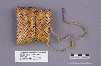 Figure 2: Envelope basket, Seminole, split palmetto, buckskin, ca. 1920s-1950s, 10 x 9 x 3 cm. Collected by John M. Goggin (84-16-E988).