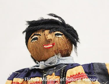 Figure 12: Male doll with yarn hair.