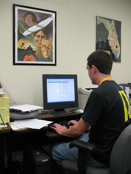Austin Bell enters data into the South Florida Archaeology database.