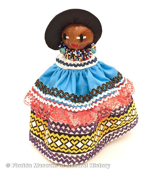 "Doll, female, Seminole, cotton cloth, glass beads, palm fiber, ca. 2000, 9.8"" high (2006-20-20)."