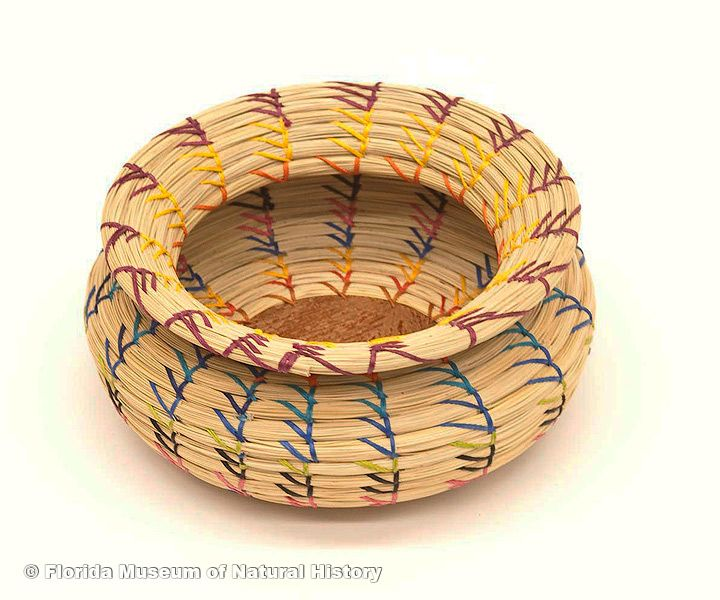 "Basket, Seminole, sweetgrass, cotton thread, palmetto fiber, early 2000s, 6.9"" long (2006-20-1)."