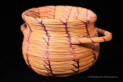 Basket, Seminole, sweetgrass, cotton thread, palmetto fiber, 2005, 8 x 19 cm. Made by Donna Frank, purchased by Darcie MacMahon and William Marquardt with museum funds (2006-20-1).