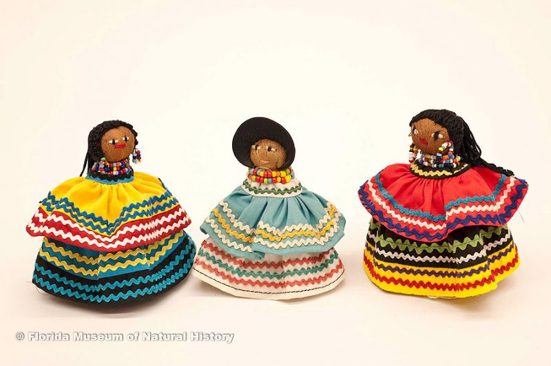 "Dolls, female, Seminole, cotton cloth, glass beads, palm fiber: ca. 2000, 4.3"" high (2006-20-19), ca. 1978, 4.5"" high (E-663), and ca. 1982, 4.9"" high (E-806)."