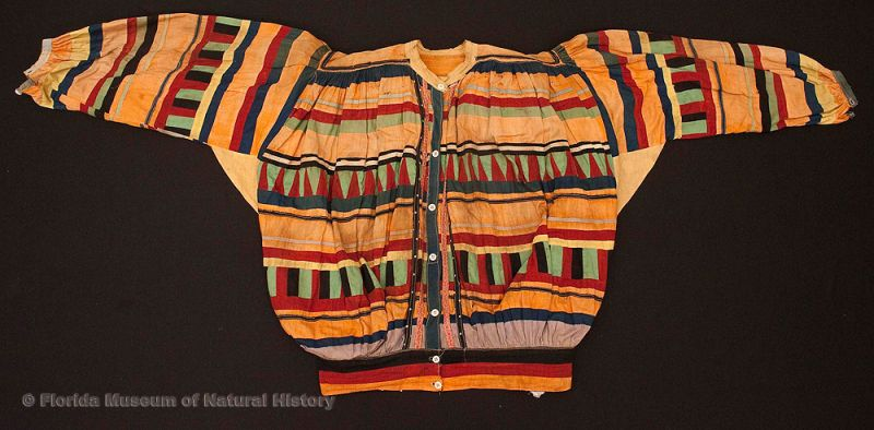 "Man's shirt, Seminole, cotton cloth and thread, ca. 1930-1950, 21.0"" top to bottom (E-982)."