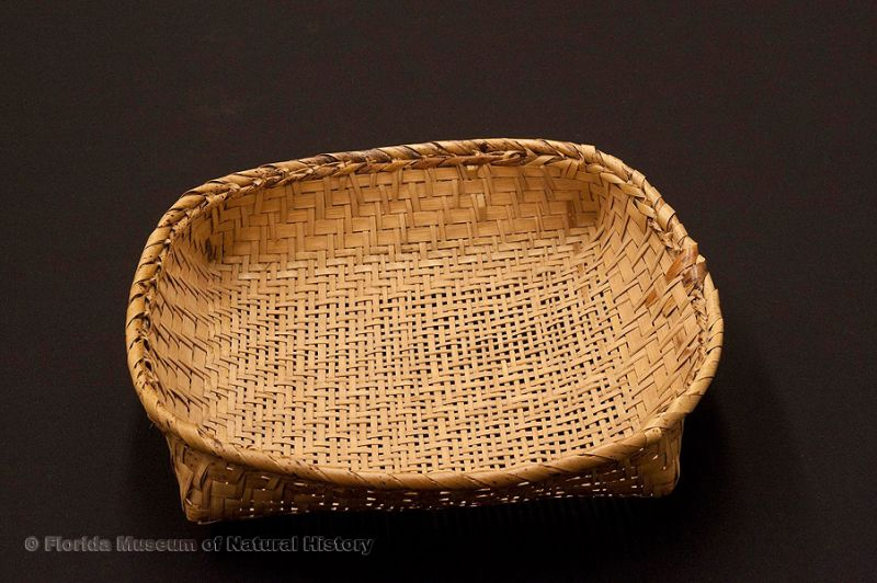 "Basket sieve, part of a set used for sifting, Miccosukee, split palmetto stems, made at Josie Billie's camp, 1939, 11.4"" long (92907)."