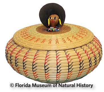 Figure 20: Seminole basket with doll head (2013-36-2) palmetto fiber, sweetgrass, cotton cloth, glass beads.