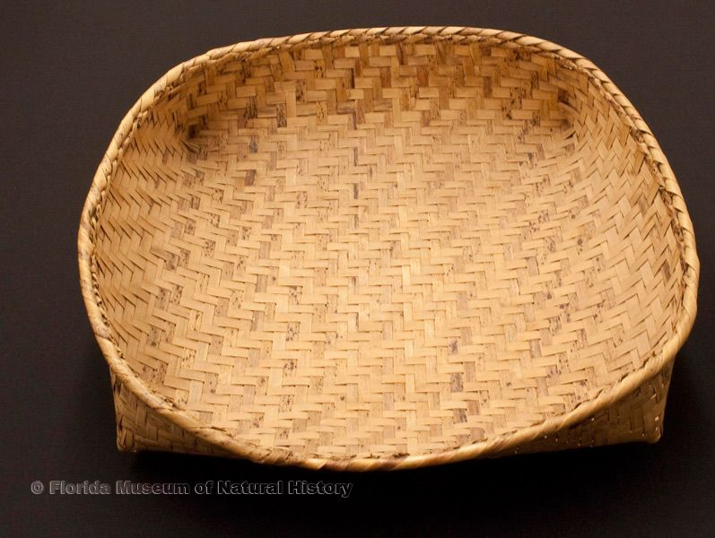 "Basket tray, part of a set used for sifting, Miccosukee, split palmetto stems, made at Josie Billie's camp, 1939, 13.8"" long (92917)."