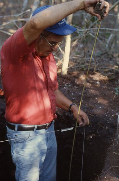 Bud House takes depth measurement, Galt Island, October 1987.