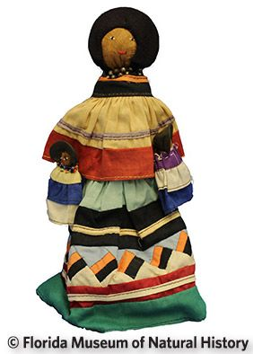 Figure 12: Female doll, Seminole (2013-36-6) Palmetto fiber, cotton cloth, metal. Date unknown, 26 cm. Donated by Keith and Sara Reeves.