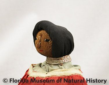 Figure 10: Female doll with cloth rolled hairsyle.