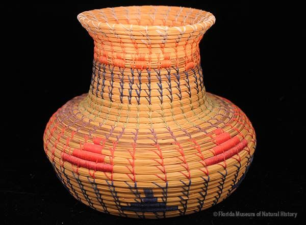 Basket, Seminole, sweetgrass, pine needles, cotton thread, palmetto fiber, ca. 1970-1990, 15.2 x 17.7 cm. Made by Paul Billie, donated by Keith and Sara Reeves (2013-46-14).