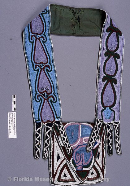 "Bandolier bag, Seminole, cotton cloth, glass beads, 19th century, 25.0"" long, 12"" wide (E-604)."