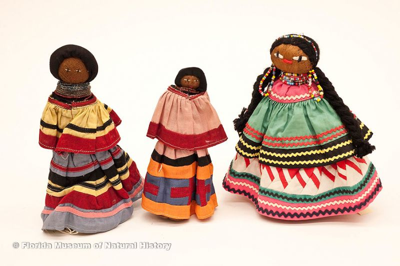 "Dolls, female, Seminole, cotton cloth, glass beads, palm fiber, early 20th century, 8.3"" high (88-6-4) and 7.3"" high (88-6-6)."
