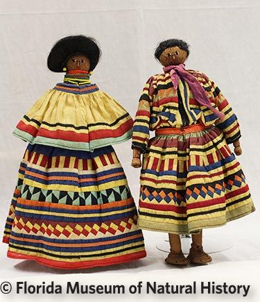 Figure 10: Male and female pair dolls, Seminole (2012-50-25/2012-50-26) Palmetto fiber, cotton cloth, glass beads, human hair (possibly). Circa 1950-1970 (30.96cm/30.48cm) Donated by Anne Reynolds.