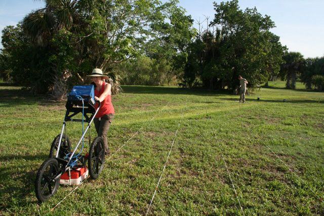 Christina Donisi operates the ground-penetrating radar data recorder at the Pineland site, July, 2011.