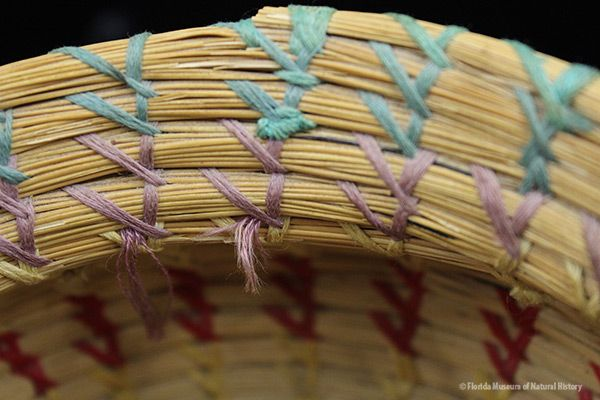 Basket, Seminole, sweetgrass, cotton thread, palmetto fiber, circa 20th c., 9.5 x 19.5 cm. Donated by Keith and Sara Reeves (2012-46-8).