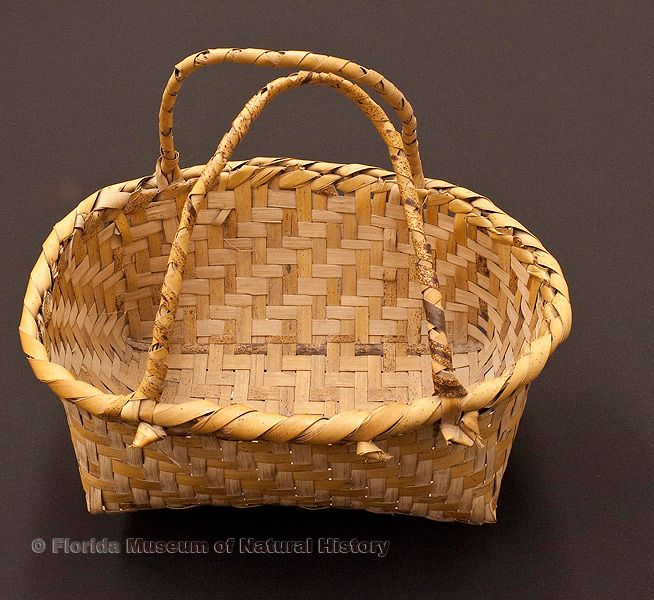 "Basket, Miccosukee/Seminole, split saw palmetto stems, 1943, purchased at Musa Isle, 14.2"" long (92922)."