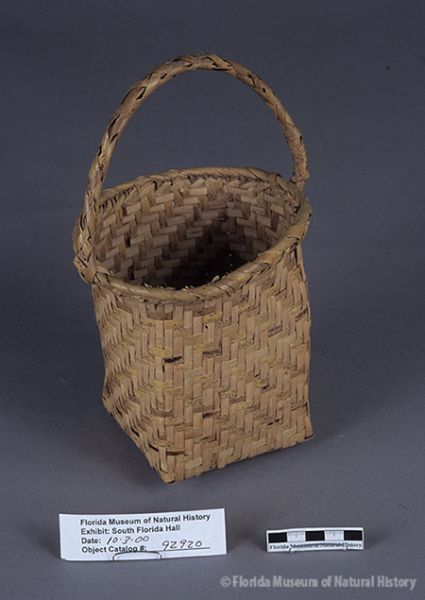Basket, Miccosukee, split palmetto, 2/2 twill, 1943, 13 x 9.9 x 9 cm (21 cm w/ handle). Collected at Big Cypress by John M. Goggin (3933-92920).