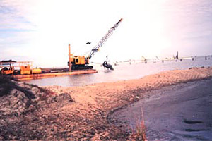 Dredging activity. Photo courtesy Dr. Terry McTigue, NOAA