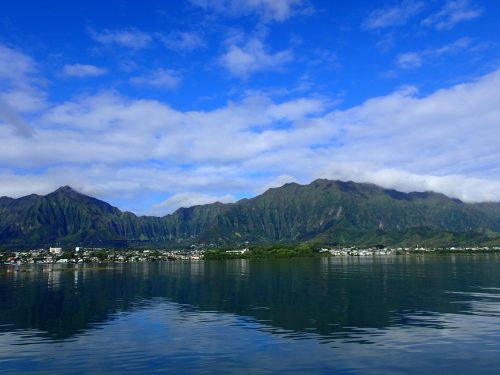 photo of Oahu from the water. big, blue sky