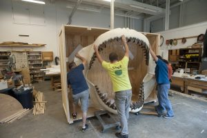 Florida Museum of Natural History staff prepare the jaw of a Megalodon shark for shipment to the Biomuseo in Panama. Florida Museum of Natural History photo by Jeff Gage