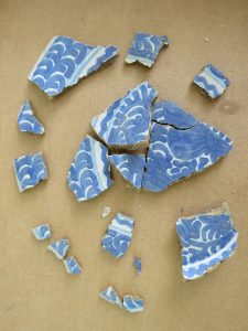 These sherds collected from the same plate are of a Spanish majolica type of pottery called San Agustin Blue on White, dating from 1700-1750. Florida Museum of Natural History photo by Gifford Waters