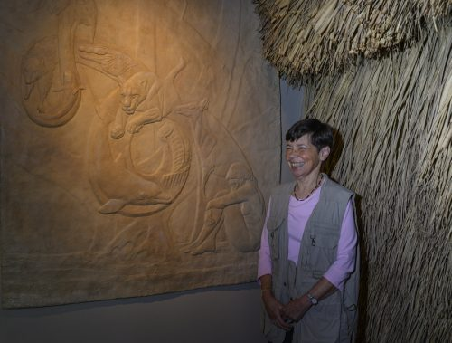 woman standing and smiling in south florida exhibit