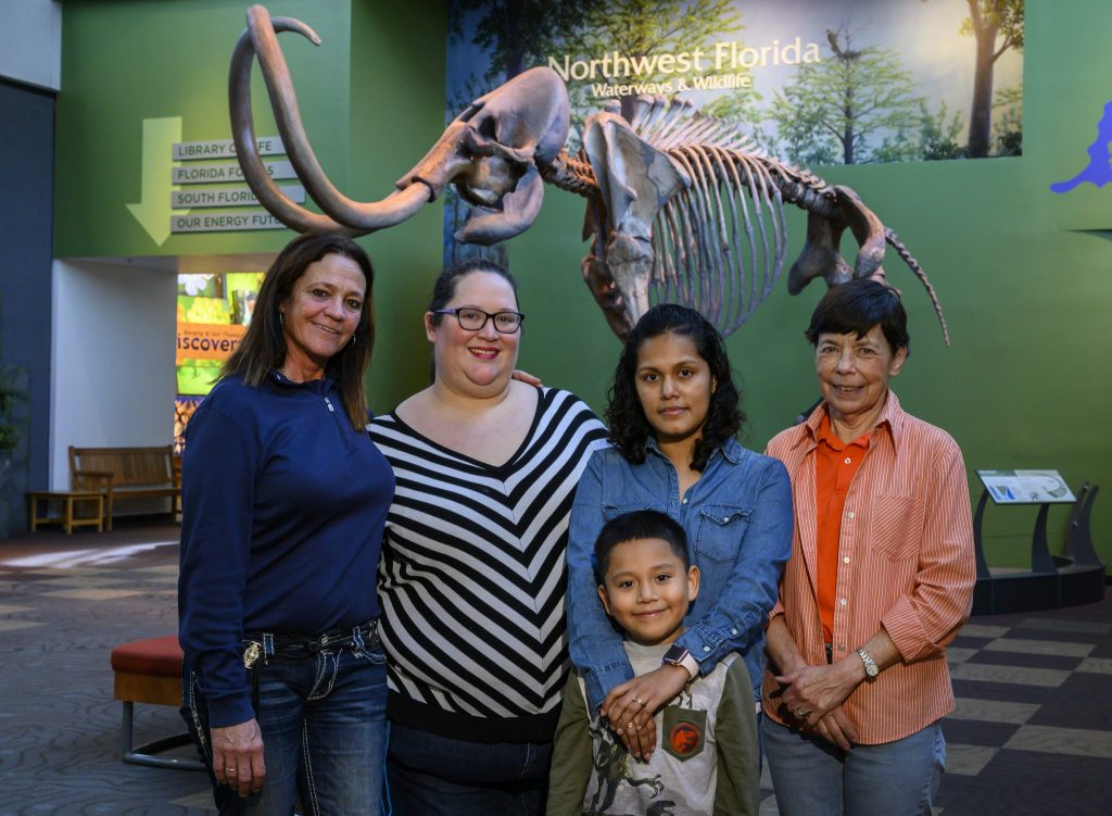group standing in front of mammoth skeleton
