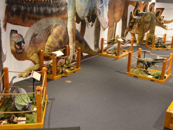 baby dinosaur statues in enclosures