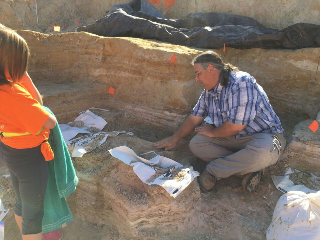 Dr. Bloch showing dig