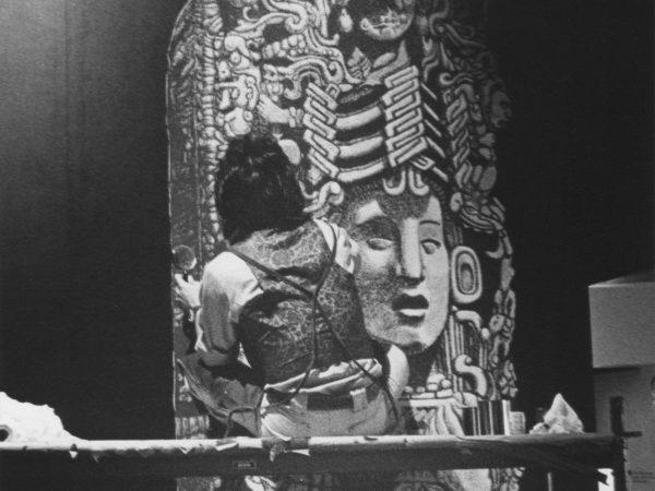 man painting Mayan stela