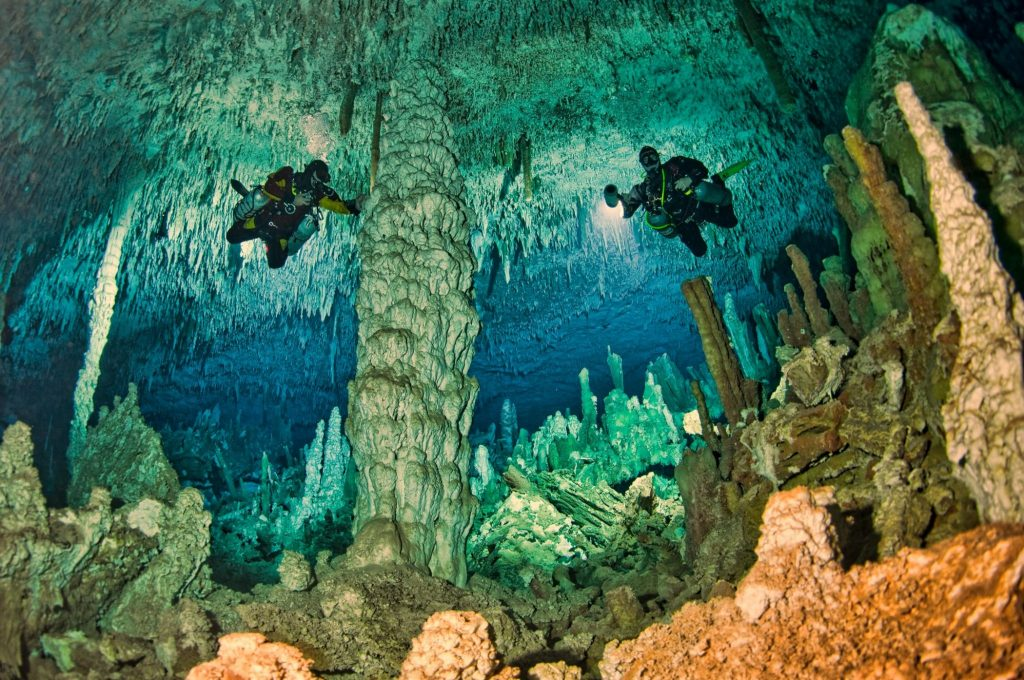 two divers in underwater cavern