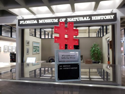 hashtag trophy on case in front fo museum sign