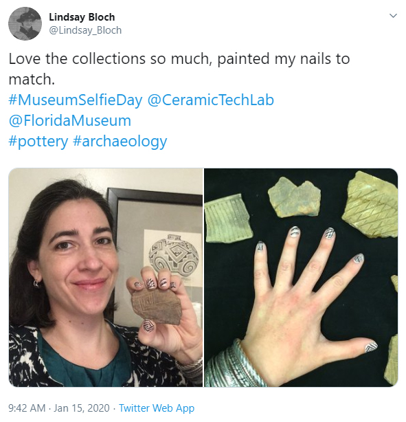 wman taking selfie with elaborately painted nails matching pottery artifacts